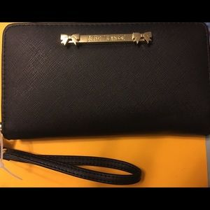 Betsy Johnson wristlet black with gold bows nwt